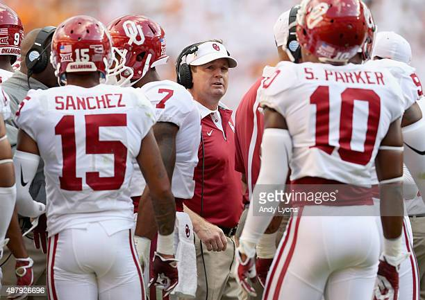 Bob Stoops the head coach of the Oklahoma Sooners talks to his team against the Tennessee Volunteers at Neyland Stadium on September 12 2015 in...