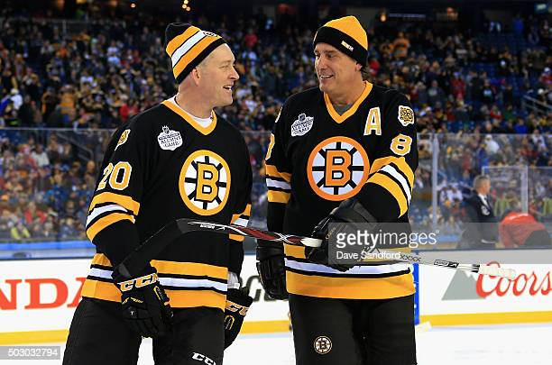 Bob Sweeney and Cam Neely of the Boston Bruins Alumni team talk on the ice before the Alumni Game as part of the 2016 Bridgestone NHL Classic at...