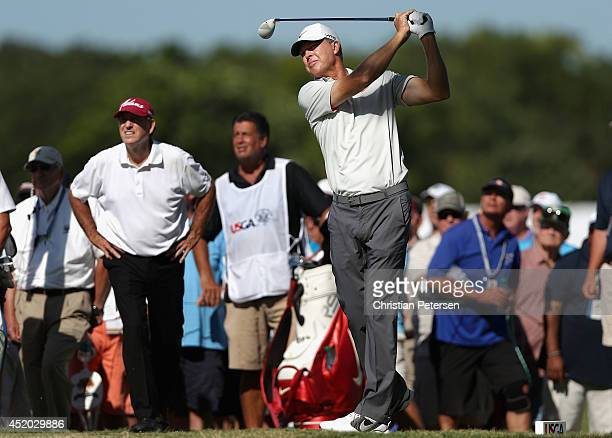 Bob Tway hits a tee shot on the 15th hole during the second round of the 2014 US Senior Open Championship at Oak Tree National on July 11 2014 in...
