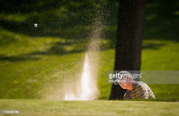 Bob Tway hits an approach shot shot on the 16th hole during the first round of the 2013 US Senior Open Championship at Omaha Country Club on July 11...