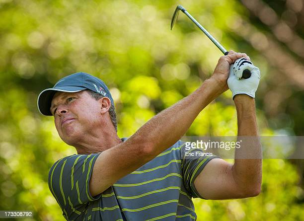 Bob Tway hits his tees shot on the 16th hole during the first round of the 2013 US Senior Open Championship at Omaha Country Club on July 11 2013 in...