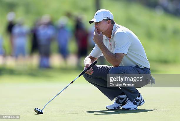 Bob Tway looks over the 17th green during the second round of the 2014 US Senior Open Championship at Oak Tree National on July 11 2014 in Edmond...