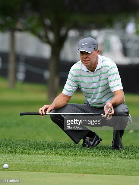 Bob Tway studies his putt on the 18th green during the second round of the Encompass Championship at North Shore Country Club on June 22 2013 in...