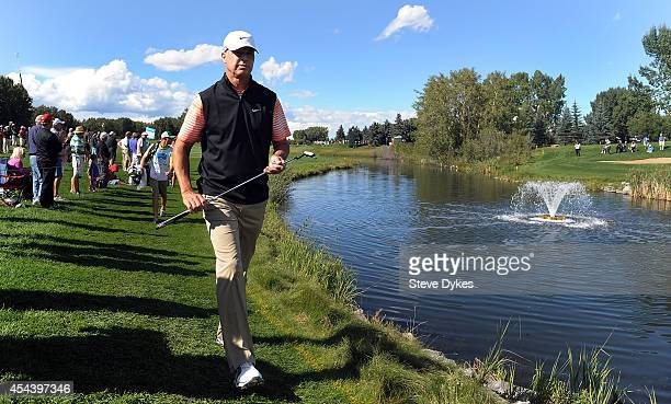 Bob Tway walks up to the 18th green during the second round of the Shaw Charity Classic at the Canyon Meadows Golf and Country Club on August 30 2014...