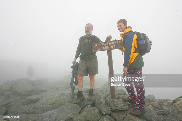 Bob Wentworth left and his grandson Austin Dermody right pause on the summit of Mt Washington after having hiked up from Lakes of the Clouds Hut