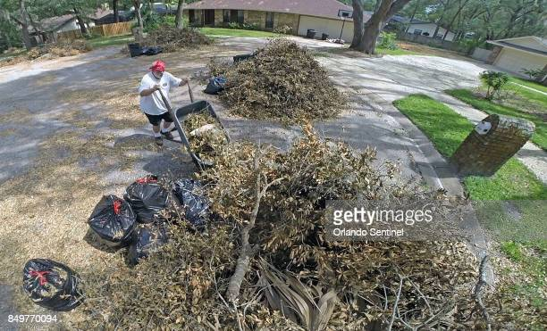Bob Williams who lives in the North Cove community in Longwood Fla adds another load of yard waste from Hurricane Irma on Tuesday Sept 19 to a pile...