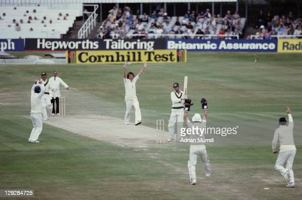 Bob Willis of England celebrates with his team mates after wicket keeper Bob Taylor dismisses John Dyson of Australia during the Australian 2nd...