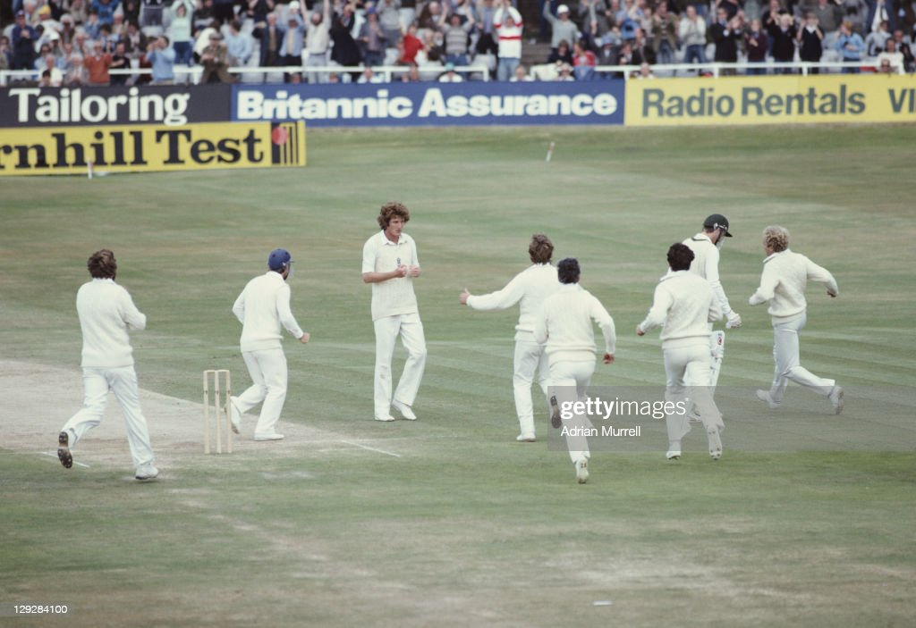 Bob Willis of England is surrounded his team mates after wicket keeper Bob Taylor dismisses Geoff Lawson of Australia during the Australian 2nd...