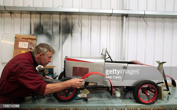Bob Woods a conservator at the Haynes Motor Museum works on a Vauxhall pedal car in the museum workshop on August 3 2010 in Yeovil England The museum...