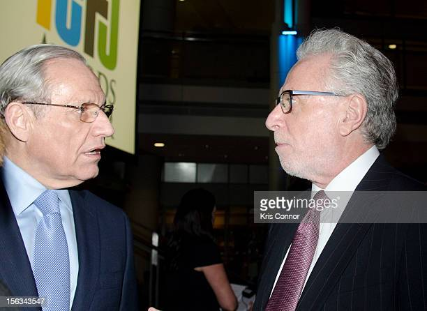 Bob Woodward and Wolf Blitzer speak during the International Center for Journalists 2012 Awards dinner at the Ronald Reagan Building on November 13...