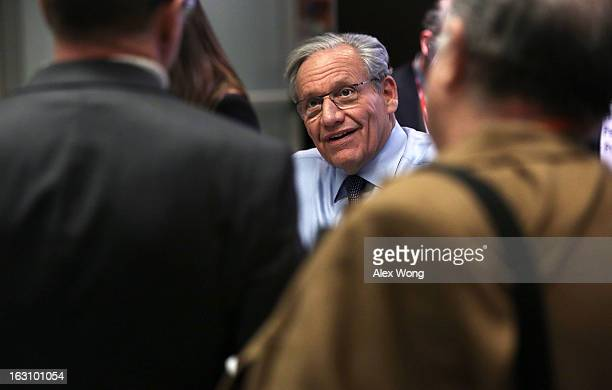 Bob Woodward associate editor at The Washington Post signs autographs during the annual conference of the National Association of Counties March 4...