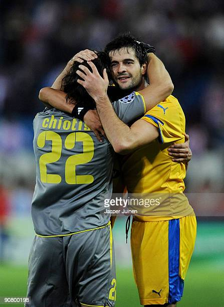 Boban Grncarov of APOEL FC celebrates with goalkeeper Dionisios Chiotis at the end of the Champions League group D match between Atletico Madrid and...