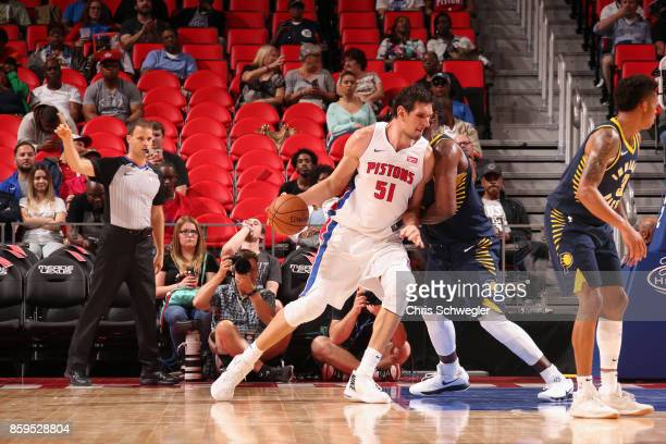 Boban Marjanovic of the Detroit Pistons drives to the basket against the Indiana Pacers on October 9 2017 at Little Caesars Arena in Detroit Michigan...