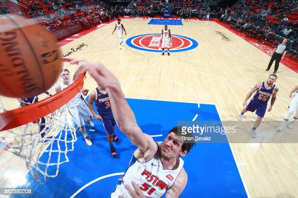 Boban Marjanovic of the Detroit Pistons drives to the basket against the Phoenix Sunson November 29 2017 at Little Caesars Arena in Detroit Michigan...