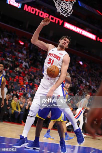 Boban Marjanovic of the Detroit Pistons dunks in the second half while playing the Golden State Warriors at Little Caesars Arena on December 8 2017...