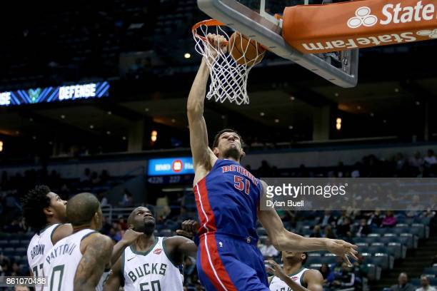 Boban Marjanovic of the Detroit Pistons dunks the ball in the fourth quarter during a preseason game against the Milwaukee Bucks at BMO Harris...