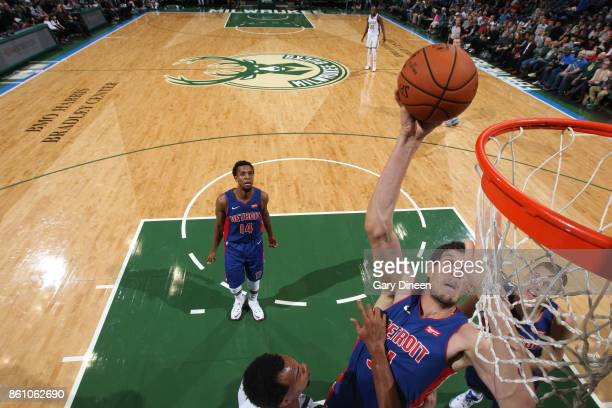 Boban Marjanovic of the Detroit Pistons goes to the basket against the Milwaukee Bucks on October 13 2017 at the BMO Harris Bradley Center in...