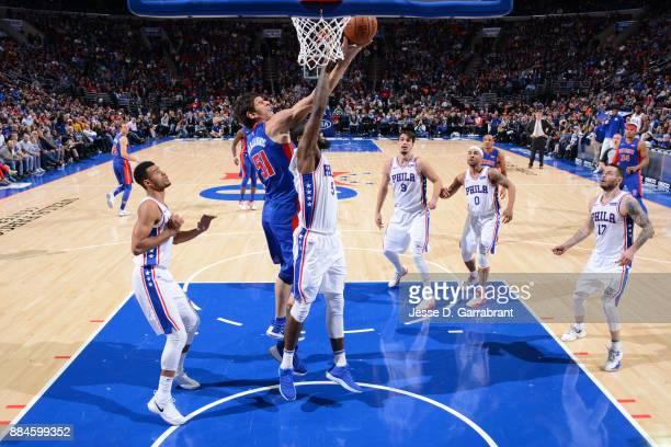 Boban Marjanovic of the Detroit Pistons goes up for a rebound against Amir Johnson of the Philadelphia 76ers on December 2 2017 at Wells Fargo Center...
