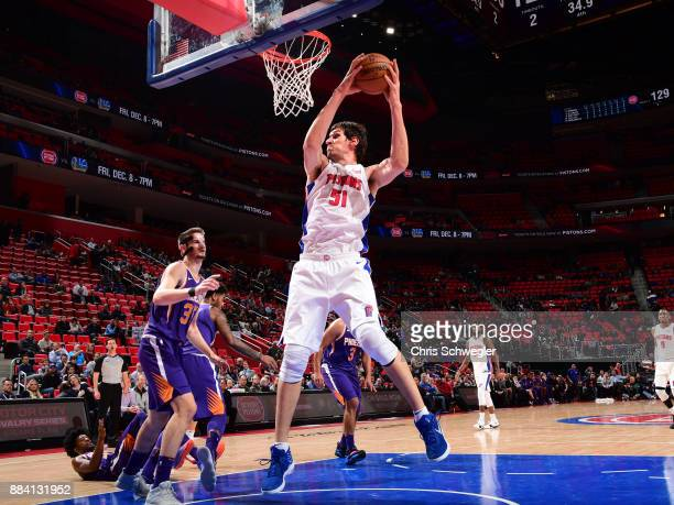 Boban Marjanovic of the Detroit Pistons grabs the rebound against Dragan Bender of the Phoenix Suns on November 29 2017 at Little Caesars Arena in...