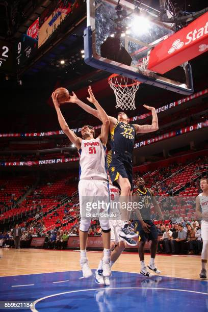 Boban Marjanovic of the Detroit Pistons grabs the rebound against the Indiana Pacers on October 9 2017 at Little Caesars Arena in Detroit Michigan...