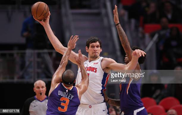 Boban Marjanovic of the Detroit Pistons looks to pass the ball late in the fourth quarter of the game against the Phoenix Suns at Little Caesars...