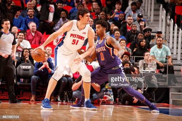 Boban Marjanovic of the Detroit Pistons looks to pass the ball against the Phoenix Suns on November 29 2017 at Little Caesars Arena in Detroit...