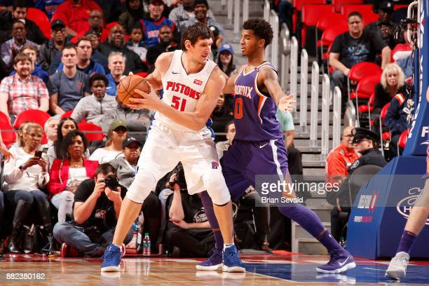 Boban Marjanovic of the Detroit Pistons moves to pass the ball against the Phoenix Suns on November 29 2017 at Little Caesars Arena in Detroit...