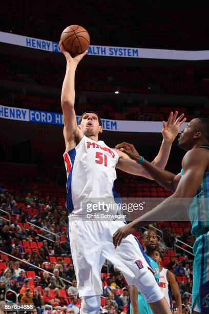Boban Marjanovic of the Detroit Pistons shoots the ball against the Charlotte Hornets during a preseason game on October 4 2017 at The Palace of...