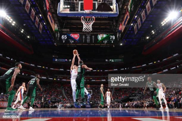 Boban Marjanovic of the Detroit Pistons shoots the ball against the Boston Celtics on December 10 2017 at Little Caesars Arena in Detroit Michigan...