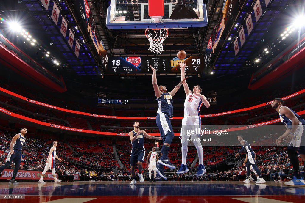 Boban Marjanovic #51 of the Detroit Pistons shoots the ball against the Denver Nuggets on December 12, 2017 at Little Caesars Arena in Detroit, Michigan.