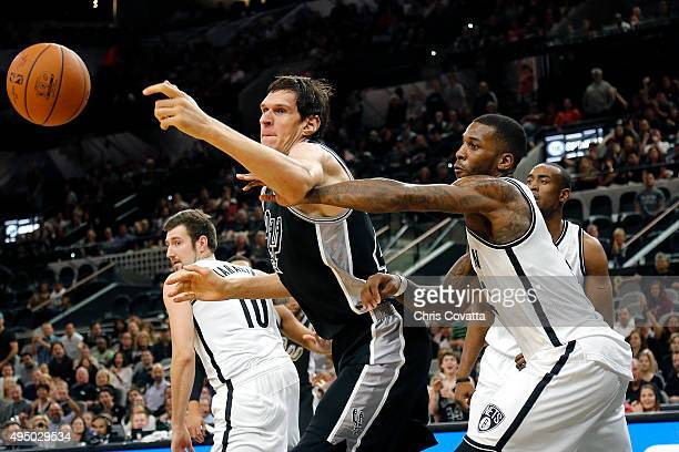 Boban Marjanovic of the San Antonio Spurs battles for a loose ball with Thomas Robinson of the Brooklyn Nets at the ATT Center on October 30 2015 in...