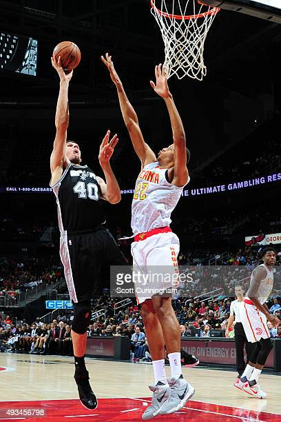 Boban Marjanovic of the San Antonio Spurs drives to the basket against Walter Tavares of the Atlanta Hawks during a preseason game on October 14 2015...