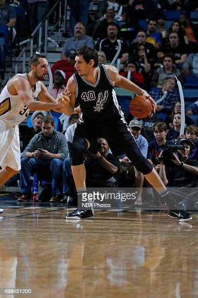 Boban Marjanovic of the San Antonio Spurs drives to the basket against the New Orleans Pelicans on November 20 2015 at the Smoothie King Center in...