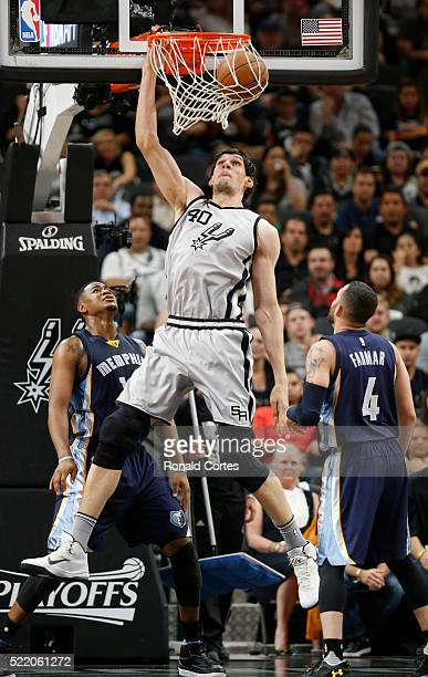 Boban Marjanovic of the San Antonio Spurs dunks in front of Jordan Farmar of the Memphis Grizzlies during Game One of the Western Conference...