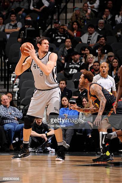 Boban Marjanovic of the San Antonio Spurs handles the ball against the Atlanta Hawks on November 28 2015 at the ATT Center in San Antonio Texas NOTE...