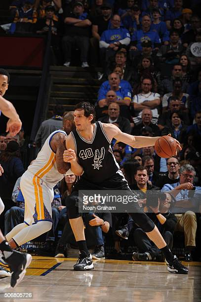 Boban Marjanovic of the San Antonio Spurs is defended by Andre Iguodala of the Golden State Warriors on January 25 2016 at Oracle Arena in Oakland...