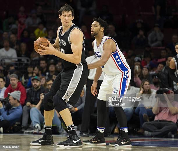 Boban Marjanovic of the San Antonio Spurs posts up Jahlil Okafor of the Philadelphia 76ers on December 7 2015 at the Wells Fargo Center in...