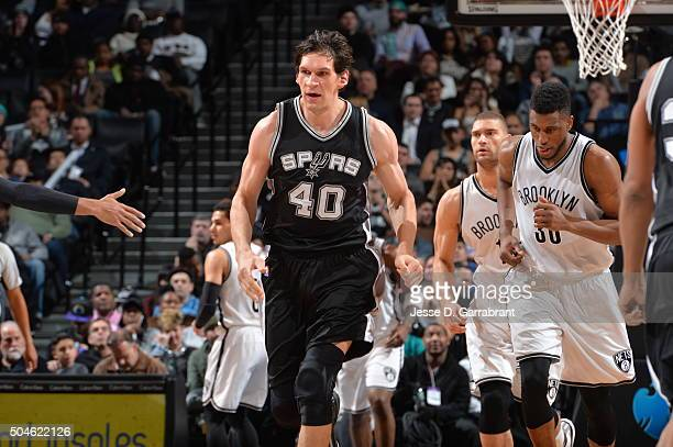 Boban Marjanovic of the San Antonio Spurs runs up court against the Brooklyn Nets on January 11 2015 at Barclays Center in Brooklyn New York NOTE TO...