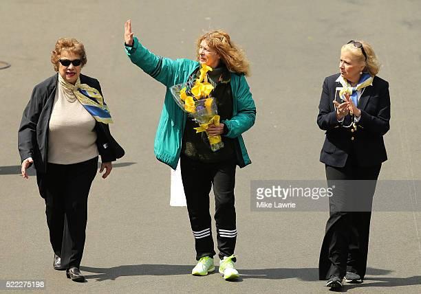 Bobbi Gibb the first woman to run the Boston Marathon crosses the finish line during the 120th Boston Marathon on April 18 2016 in Boston...