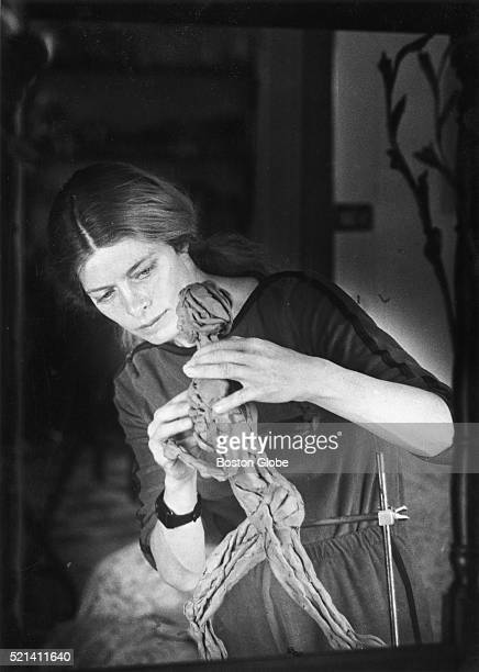 Bobbi Gibb who was the first woman to finish the Boston Marathon works on a sculpture of a runner March 25 1983