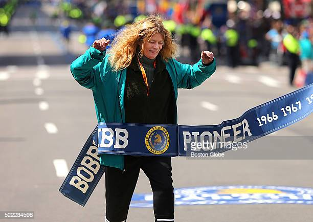 Bobbi Gibb who was the first women to finish the Boston Marathon in 1966 crosses a ceremonial finish line on Boylston Street to commemorate her...