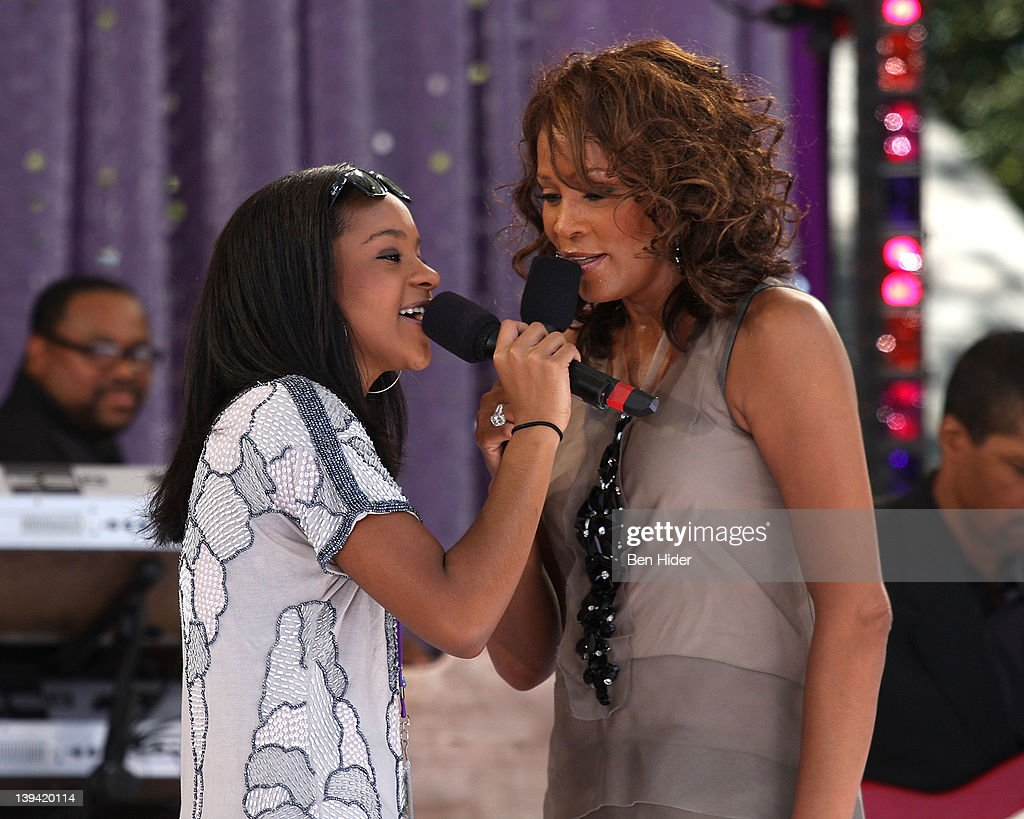 Bobbi Kristina Brown and Whitney Houston perform in Central Park on September 1 2009 in New York City
