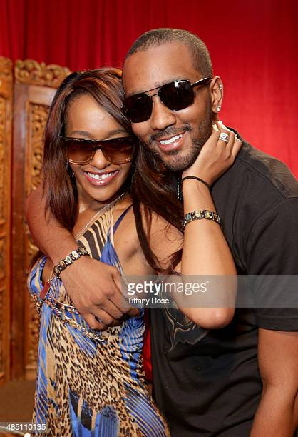 Bobbi Kristina Brown wearing Bobbi Brown Eyewear and Nick Gordon wearing Polaroid PLUS sunglasses with the Solstice Sunglasses and Safilo USA display...