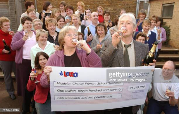 Bobbie Howard syndicate organizer and Phillip Percival Headmaster toast each other with Champagne watched by other teachers cleaners dinner ladies...