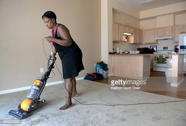 Bobbie Vaughns uses the residence communal vacuum cleaner inside her new one bedroom unit at the Stout Street Lofts The Colorado Coalition for the...