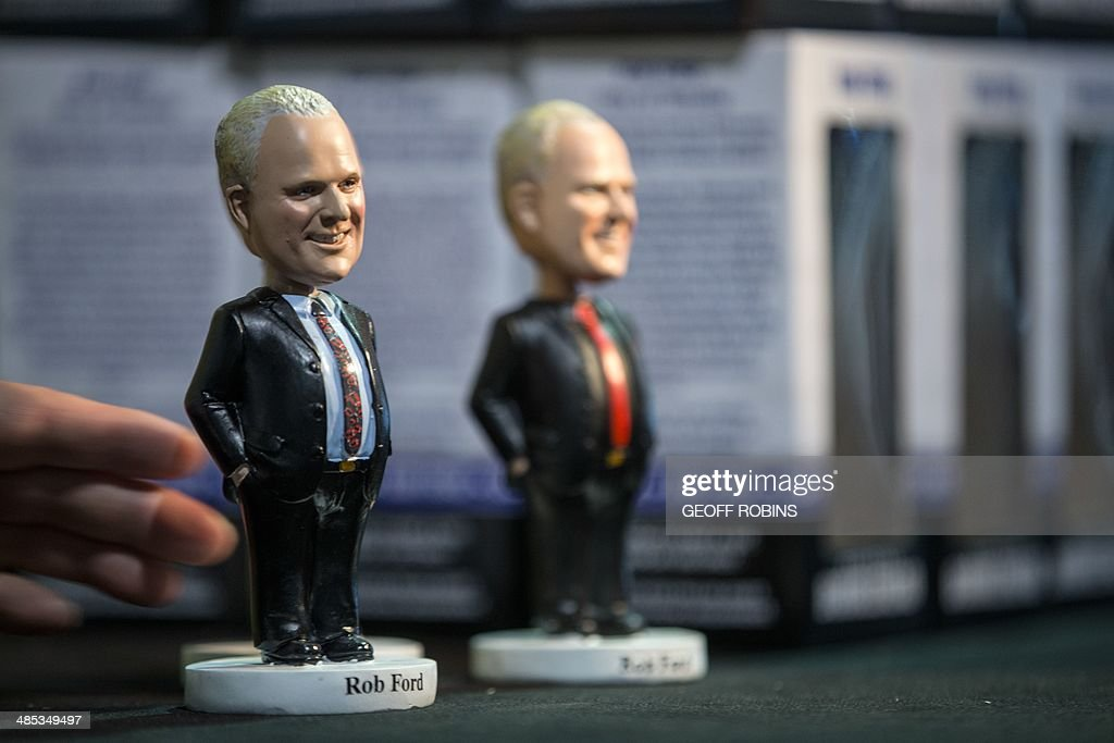 Bobble head dolls of Toronto Mayor Rob Ford sit on a table as the mayor prepares to kick off his re-election campaign at a rally in Toronto on April 17, 2014. Ford, who made worldwide headlines last year after admitting binge drinking and smoking crack, has been stripped of most of his powers. AFP PHOTO/GEOFF ROBINS