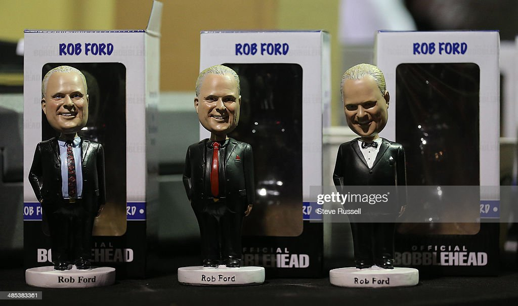 TORONTO, ON- APRIL 17 - Bobbleheads sell for, from, left, $100, $30 and $30 as Toronto Mayor Rob Ford launches his re-election campaign at the Toronto Congress Centre in Toronto. April 17, 2014.
