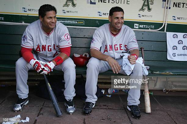 Bobby Abreu and Juan Rivera of the Los Angeles of Anaheim sit in the dugout prior to the game against the Oakland Athletics at the OaklandAlameda...