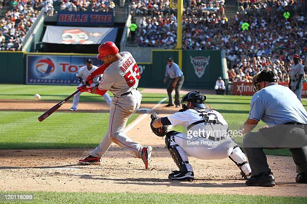 DH Bobby Abreu of the Los Angeles Angels of Anaheim swings and makes contact against the Detroit Tigers during a MLB game at Comerica Park on July 30...