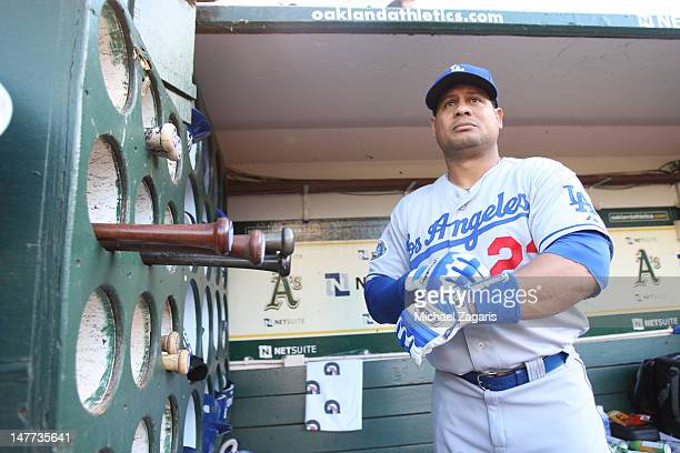 Bobby Abreu of the Los Angeles Dodgers stands in the dugout prior to the game against the Oakland Athletics at the OaklandAlameda County Coliseum on...